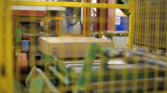 Moving cardboard box on conveyor belt Stock Footage