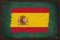 spain flag painted with chalk on blackboard - stock photo