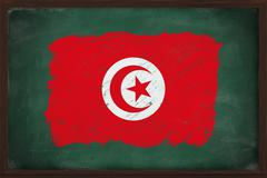 tunisia flag painted with chalk on blackboard - stock photo
