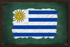uruguay flag painted with chalk on blackboard - stock photo