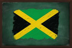 jamaica flag painted with chalk on blackboard - stock photo