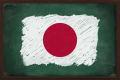 japan flag painted with chalk on blackboard - stock photo