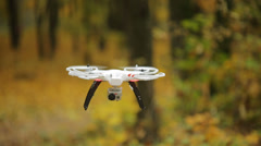The quadrocopter with camera on it for aerial shots - stock footage