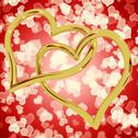 Stock Illustration of gold heart shaped rings on red bokeh representing love and romance