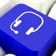 Headset symbol computer key in blue showing communiction and online assistanc Stock Illustration