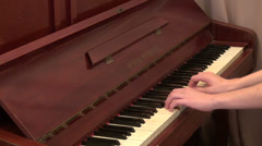 Hands playing the piano, teenager practicing, music lesson Stock Footage