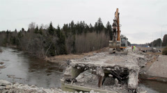 River flowing under the damaged bridge Stock Footage