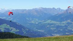 Paragliding over the mountains against clear blue sky, Kronplatz, Italy HD Stock Footage