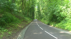 Traffic in sunken lane in the hills of the Dutch Province South Limburg Stock Footage
