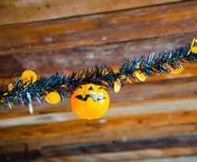 decorate plastic pumpkin on rainbow part - stock photo