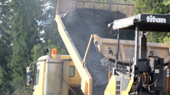 Dumptruck dumping gravel in the site Stock Footage