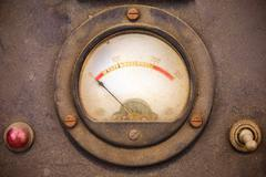 Vintage dusty volt meter in a metal casing Stock Photos