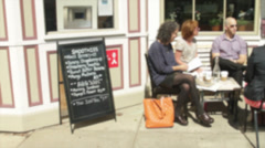 People sitting outside a small cafe on sidewalk (2 of 3) Stock Footage