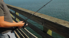 Man fishing off pier Stock Footage