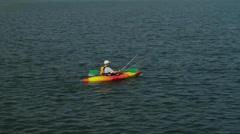 Man kayaking in open water Stock Footage
