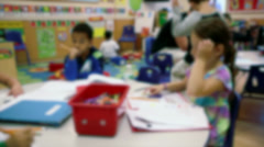 Elementary school-aged children working at tables (1 of 4) Stock Footage