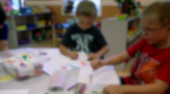 Elementary school-aged children working at tables (4 of 4) Stock Footage