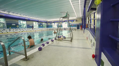 Few people swimming in indoor swimming pool (1 of 4) Stock Footage