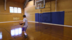 Boy playing indoor basketball alone (1 of 3) Stock Footage