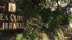 Sea Cliff Library sign Stock Footage