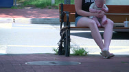 Stock Video Footage of Family relaxing on a bench (2 of 2)