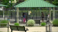 Small children frolicking on a playground (1 of 3) Stock Footage