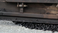 Applying asphalt on the highway with the help of an asphalt paver Stock Footage