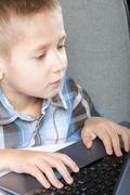 computer addiction child with laptop notebook - stock photo