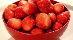 Strawberries in a red cup Stock Footage