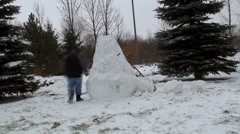 Building ugly big snowman Stock Footage
