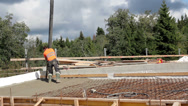 477 construction men pouring cement on a building being constructed Stock Footage