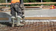 476 pouring cement on a deep area Stock Footage