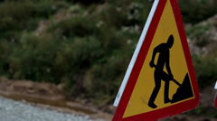 480 closer image of the men working sign next to the road Stock Footage