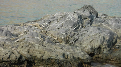 Basalt rock formations on the shore of Rhodes Stock Footage