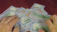 Stock Video Footage of new blue 100 dollar bills money cash US 2