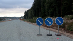 Road signs at the side of the road showing road is under construction Stock Footage