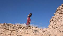Girl at archeological site Stock Footage