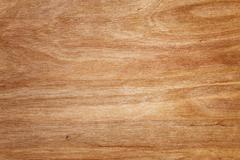 Texture of fine pine wood toned in light brown color Stock Photos