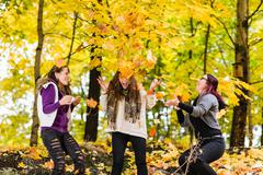 sisters and autumn - stock photo