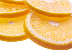 Background with citrus-fruit of orange slices. closeup. Stock Photos