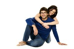 Beautiful couple smiling isolated on a white background Stock Photos
