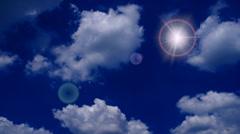 Blue sky with sun and cloud closeup Stock Footage