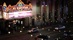El Capitan Disney Theatre Walk of Fame Hollywood Boulevard Car Traffic Night Lit Stock Footage