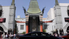 TCL Chinese Theatre Walk Fame Hollywood Boulevard Car Traffic Rush Hour Busy LA Stock Footage