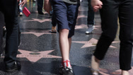 Stock Video Footage of Walk of Fame Hollywood Boulevard Celebrities Stars People Walking Crowds Moving