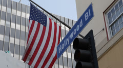 United States Traffic Hollywood Street Sign American Flag Corporate Building USA Stock Footage