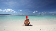 Woman in Santa Claus hat Stock Footage