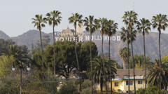 Hollywood Sign and Tower Los Angeles Hills Valley Palm Trees Vacation Sunny Day Stock Footage