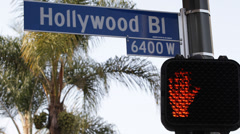 Stock Video Footage of Crosswalk Hollywood Street Sign Traffic Light Los Angeles Crossroad Palm Tree LA