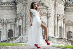 young woman in a white long dress - stock photo